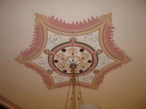 Jarring colours applied to ceiling rose