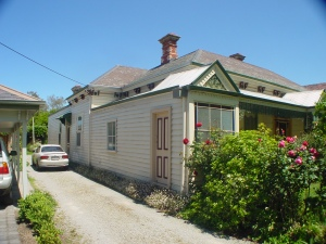Victorian home before restoration, verandah enclosed