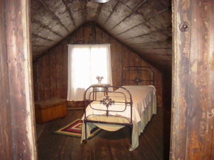 Portable Iron House upstairs bedroom