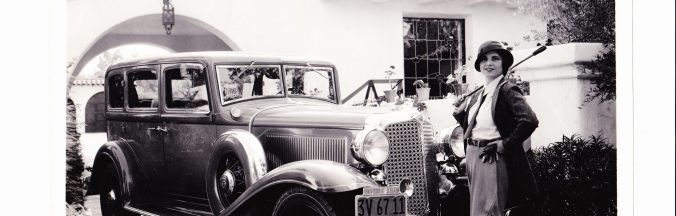 Claire-Mackinnon-and-car.-1920x616